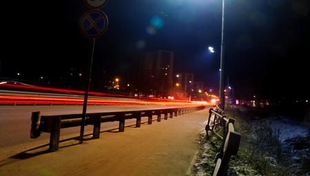car light trails on the street,  night street background.  Long exposure photo  写真素材