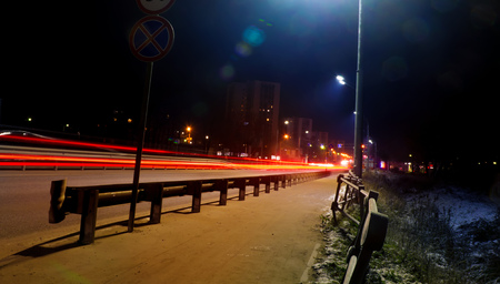 car light trails on the street,  night street background.  Long exposure photo  Фото со стока