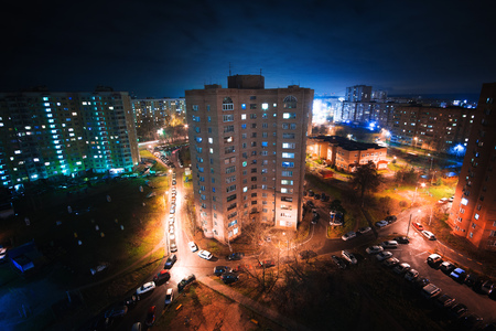 dormitory area architecture, the usual panel house at night, the block of flats, aerial shot from drone