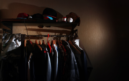 wardrobe of a guy, a teenager, a man at home. Clothes on a hanger Foto de archivo