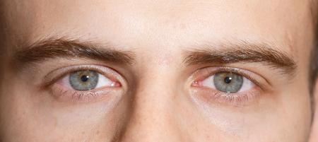 man with  blue eyes looking at the camera, macro shot