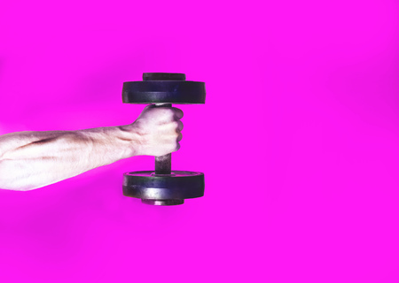 athlete bodybuilder, holding in hand a dumbbell, muscular hand on a pink background, your text there, flat, concept sports lifestyle