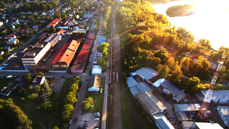 Aerial photo of railroad in city and trees