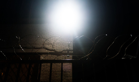 Barbed wire fence on a black background in night, prison, concept of salvation, Refugee, Silent,  lonely,  freedom
