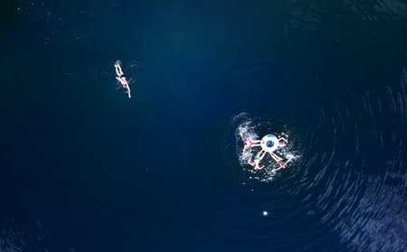 people swim in the river have a good time, photo from drones, summer holidays