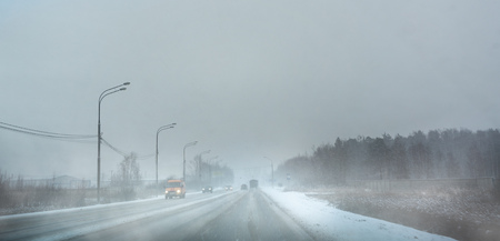 foggy gray road in bad weather, poor visibility 写真素材