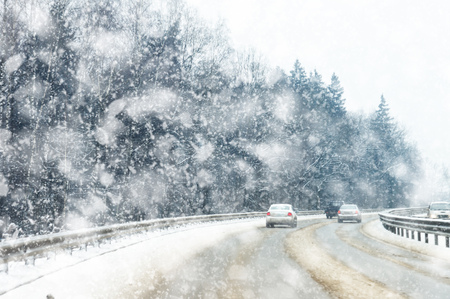 snowy road in winter, poor visibility