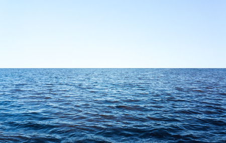 blue empty ocean, lake, clear horizon, blue sky background