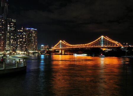 View From City Reach Boardwalk The Brightly Illuminated Story Bridge In Brisbane At Night Queensland Australia