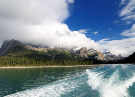 Boat Trip Between Majestic Snowy Mountains On Lake Maligne Jasper National Park