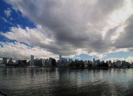 View From Stanley Park To Large Clouds Above The Vancouver Skyline