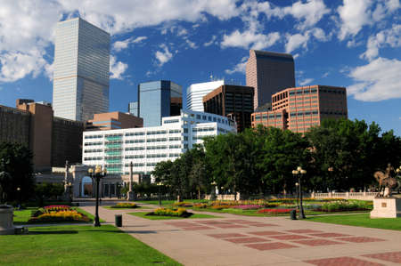 View From The Civic Center Park To The Skyscrapers Of The Financial District In Denver Colorado On A Sunny Summer Day With A Clear Blue Sky And A Few Clouds