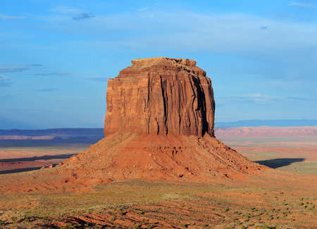 View To The Merrick Butte In The Monument Valley Arizona In The Late Afternoon Sun On A Sunny Summer Day With A Clear Blue Sky And A Few Clouds