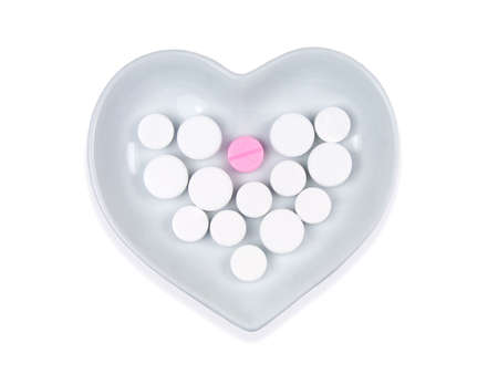 pills in a heart shaped bowl