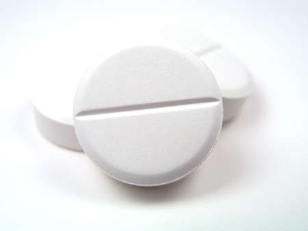 white pills on white background