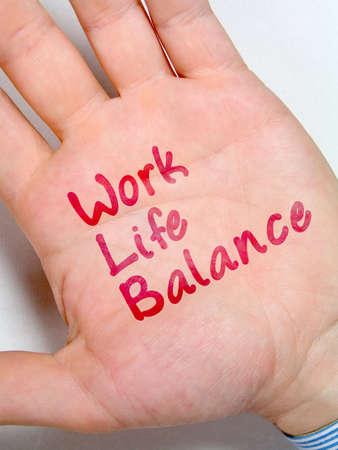 work life balance, written on businessman's hand