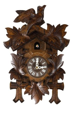 Here is a picture of a wooden German Cuckoo clock isolated on white photo