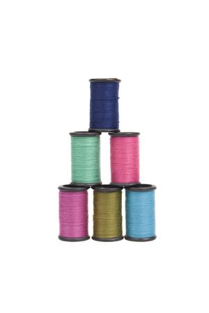 darn: a pyramid of colorful spools of thread isolated on white
