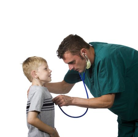 doctor examines a young child photo