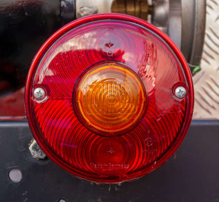 Detail shot of a taillight on a vintage fire department car