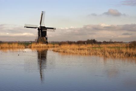 lows: Windmill Broekmolen in the Dutch region Alblasserwaard Stock Photo