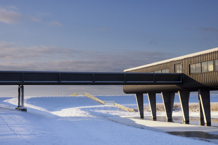 The Wouda pumping station visitor center in a snowy landscape near the Frisian town Lemmer
