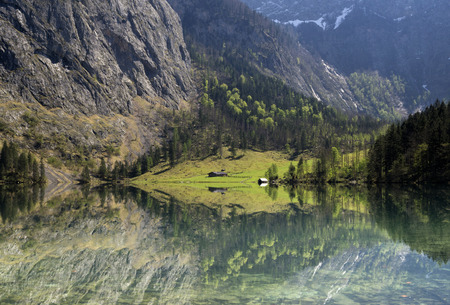 other side of: Lake Obersee in the Berchtesgaden Alps. The Fischunkelalm can be seen on the other side of the lake. Stock Photo