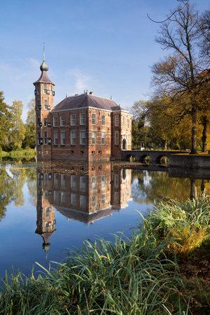 draw bridge: Bouvigne castle near Breda with autumn colored trees