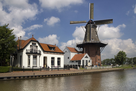 ee: Swallow the windmill along the river Dokkumer Ee in the frisian village Burdaard Editorial