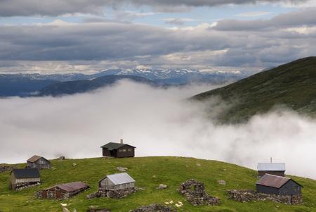 farmhouses: Farmhouses on the Aurlandsfjellet in the Norwegian county of Sogn og Fjordane Stock Photo