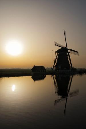 Achtkante mill near Groot-Ammers in the Dutch region Alblasserwaard in backlight Stock Photo