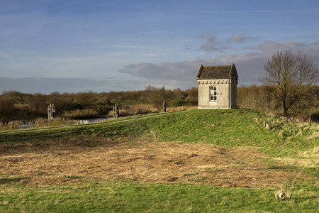 Gauge house near the locks of Benedensas near the Dutch town Steenbergen Stock Photo