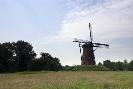 maas: Windmill the Houthuizermolen is a beltmill near the Dutch village Lottum in the province Limburg Stock Photo