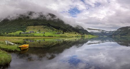 Panoramic view over lake Dalavatnet near the Norwegian town Sogndal on a clear and crisp day 写真素材