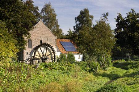 The Schouwsmolen is a watermill on the Itterbeek river in the Dutch village Ittervoort 版權商用圖片