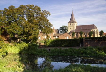 View over the Uffelse brook at Grathem church in the Dutch province Limburg 版權商用圖片