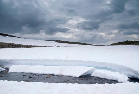 Snow covered landscape on the Norwegian mountain plateau Aurlandsfjellet close to village Laerdal