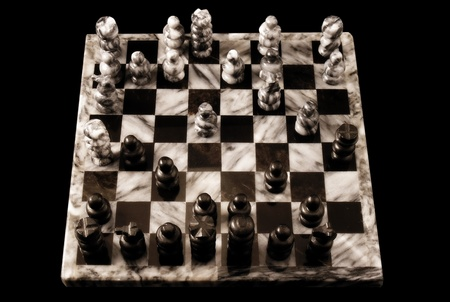 A marble chessboard isolated on a white background    Standard-Bild