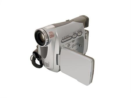 白い背景に分離したデジタル ビデオ カメラ
