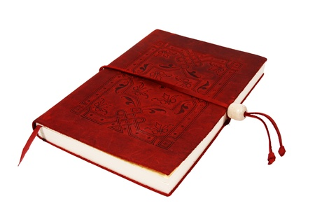 A red leather bound diary isolated on a white background   A small red bookmark is sticking out the bottom