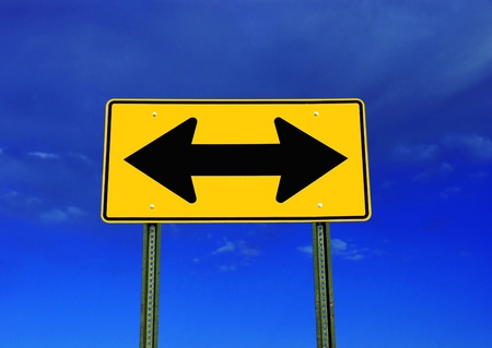 A road sign on a brilliant blue sky  Symbolizes a decision needs to be made