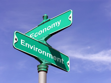 Economy VS Environment   A sign that symbolizes where economy and environment intersect  Stock Photo