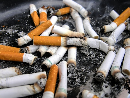 Smoking Cigarette Butts Stock Photo