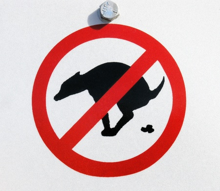 A sign that says no pet waste allowed