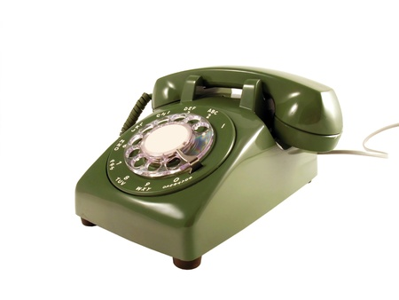 A retro rotary phone, isolated on white  Stock Photo