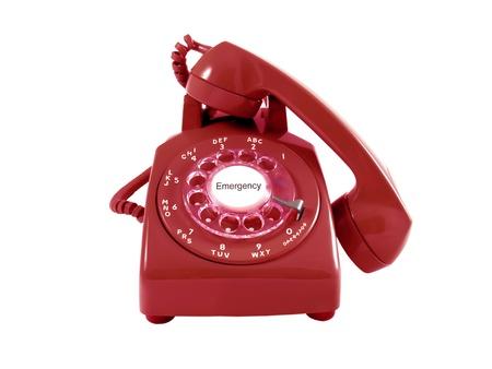 흰색으로 격리하는 빨간색 복고 로타리 전화 다이얼 센터에서 긴급 텍스트 스톡 콘텐츠