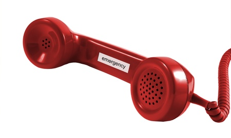 emergency call: A red retro phone receiver isolated on red  Stock Photo