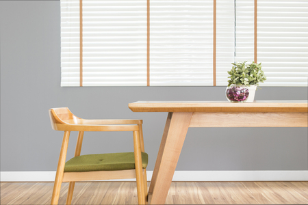 Dining table set with chair in the cozy dining room with grey wall. 版權商用圖片
