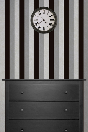 black wooden cabinet and clock in empty room with black and white wallpaper. vintage style 版權商用圖片