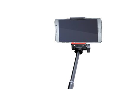 close up of empty smartphone screen with selfie stick isolated on white background